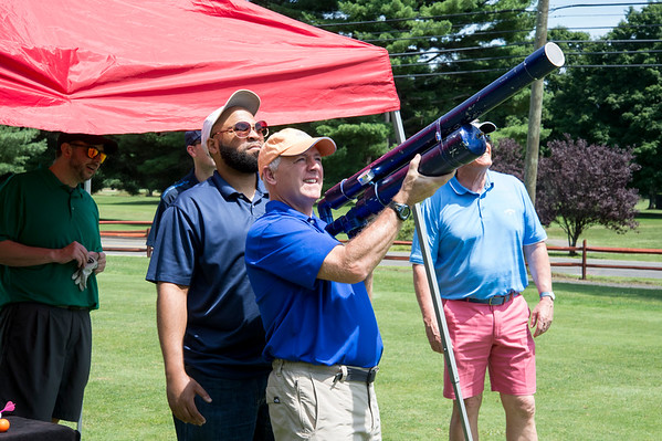 08/05/19 Wesley Bunnell | Staff Jim Forker from Thomaston Savings Bank uses a golf ball cannon during a closest to the target contest as Gil Bransford from CT Golf Event Planner helps align the shot. The Bristol Chamber of Commerce held their annual golf tournament on Monday at Tunxis Country Club in Farmington.