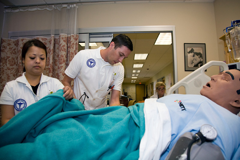 Sacramento City College Extended Campus nursing students Maiyen Tran and Brian Bangs participate in a CVA simulation exercise in the SCC/EX sim lab while instructor Jill Clary observes.