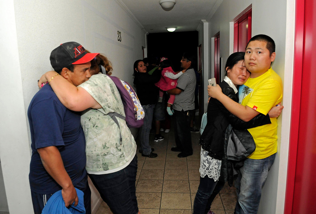 . People embrace on the upper floor of an apartment building located a few blocks from the coast where they gathered to avoid a possible tsunami after an earthquake in Iquique, Chile, Tuesday, April 1, 2014. A powerful magnitude-8.2 earthquake struck off Chile\'s northern coast Tuesday night. There were no immediate reports of injuries or major damage, but buildings shook in nearby Peru and in Bolivia\'s high altitude capital of La Paz. (AP Photo/Cristian Viveros)