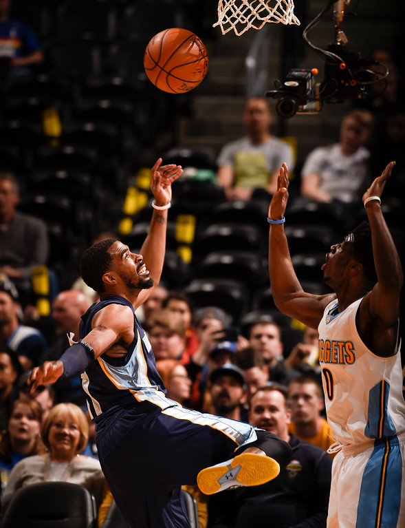 . DENVER, CO - FEBRUARY 29: Memphis Grizzlies guard Mike Conley (11) loses the ball in front of Denver Nuggets guard Emmanuel Mudiay (0) February 29, 2016 at Pepsi Center. (Photo By John Leyba/The Denver Post)