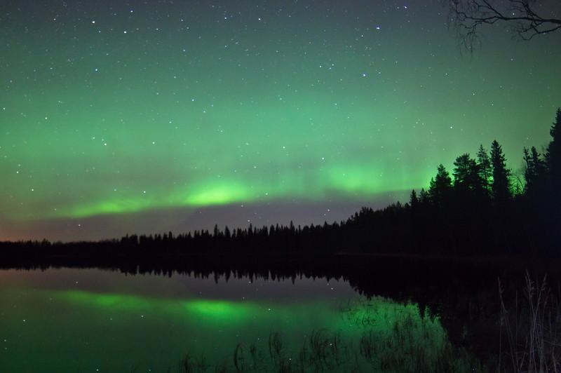 Aurora Borealis above a lake near Oulu