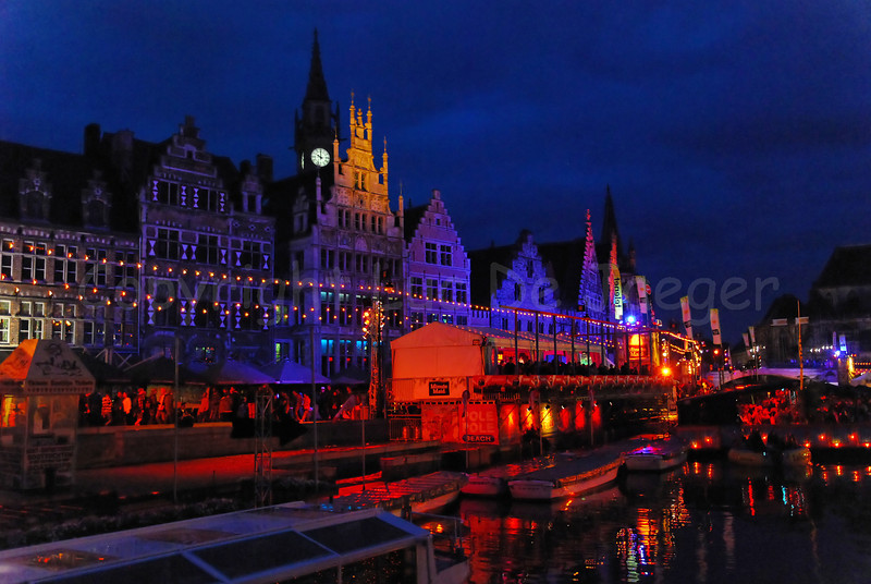 The highly colorful Polé Polé Festival during the Ghent Festivities (Gentse Feesten) 2011 in Ghent (Gent), Belgium is one of the many attractions bringing thousands of people to the place between Graslei and Korenlei.