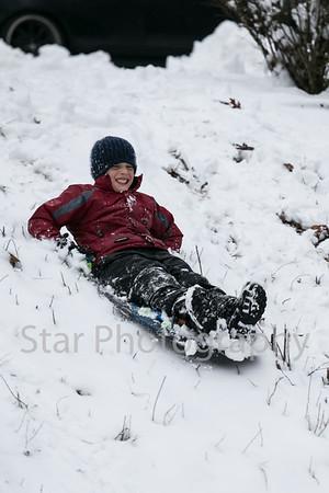 Children Sledding In Snow In Golf Course Acres 02-26-15