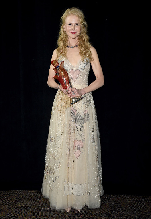 ". Nicole Kidman poses backstage with the international star award for ""Lion\"" at the 28th annual Palm Springs International Film Festival Awards Gala on Monday, Jan. 2, 2017, in Palm Springs, Calif. (Photo by Jordan Strauss/Invision/AP)"