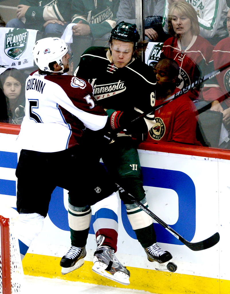 . Minnesota\'s Mikael Granlund, right, collides with Colorado\'s Nate Guenin during the first period. (Pioneer Press: Sherri LaRose-Chiglo)