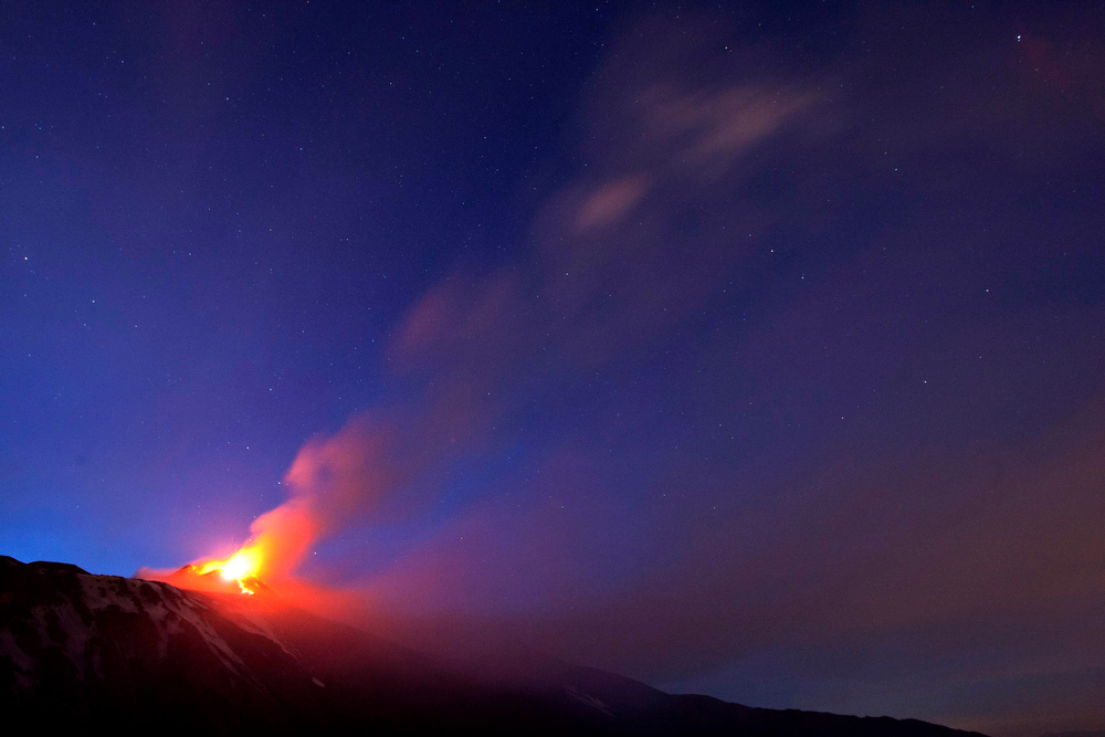 . Italy\'s volcanic Mount Etna spews lava during an eruption on the southern Italian island of Sicily April 11, 2013. Mount Etna is Europe\'s tallest and most active volcano. Picture taken April 11, 2013. REUTERS/Antonio Parrinello