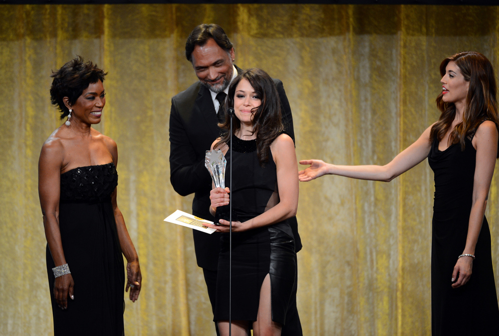 ". Actress Tatiana Maslany accepts the Best Actress in a Drama Series award for ""Orphan Black\"" from actors Angela Bassett and Jimmy Smits onstage during Broadcast Television Journalists Association\'s third annual Critics\' Choice Television Awards at The Beverly Hilton Hotel on June 10, 2013 in Los Angeles, California.  (Photo by Mark Davis/Getty Images for CCTA)"