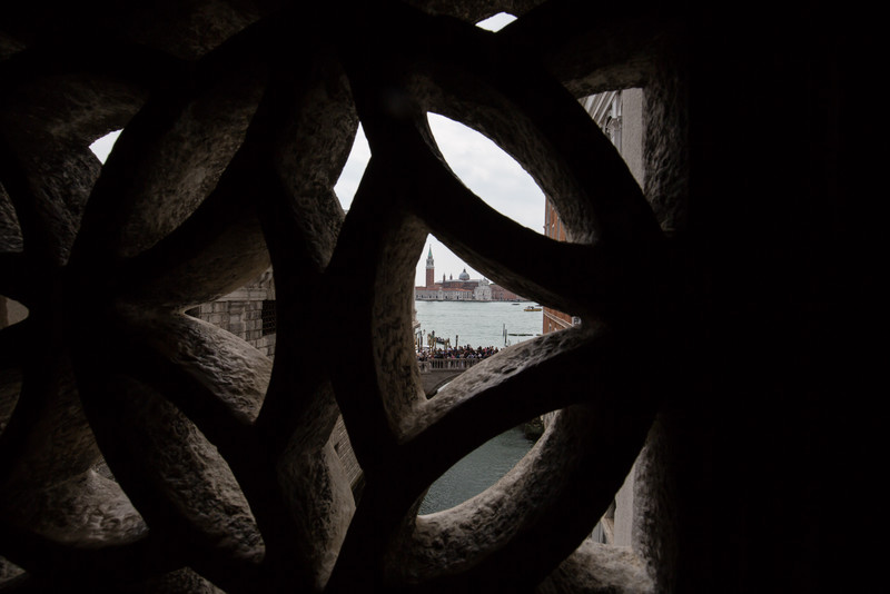 A view of Church of San Giorgio Maggiore and the lagoon from inside the bridge of sighs.