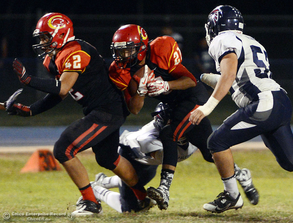. Chico High\'s #21 Cameron Alfaro (center) rushes against Central Valley High in the first quarter of their football game at Asgard Yard Friday, September 27, 2013, in Chico, Calif.  (Jason Halley/Chico Enterprise-Record)