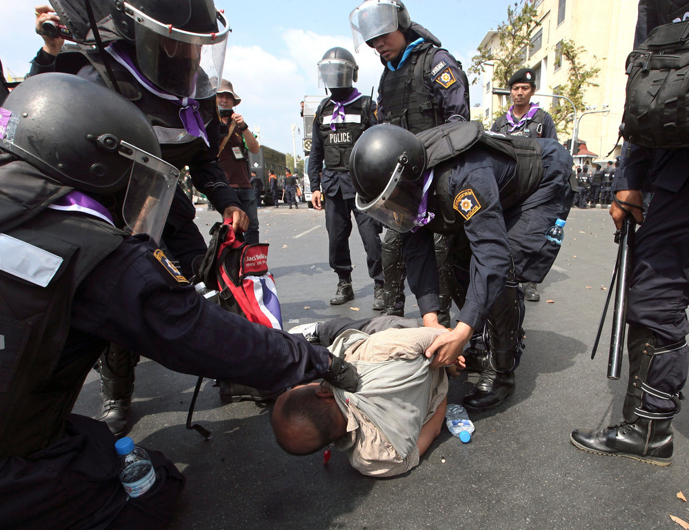 . A Thai anti-government protester is arrested during clashes with policemen at a protest site in Bangkok, Thailand, 18 February 2014.  EPA/PETER CHAN