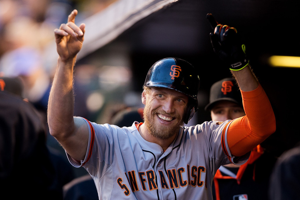 . Hunter Pence #8 of the San Francisco Giants celebrates in the dugout after hitting a home run during the fourth inning against the Colorado Rockies at Coors Field on May 21, 2014 in Denver, Colorado. The Giants defeated the Rockies 5-1. (Photo by Justin Edmonds/Getty Images)