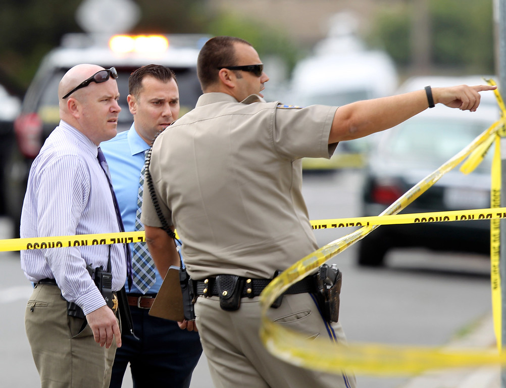 . Law enforcement investigators arrive at the scene where a Hayward police officer was killed near Lion and Myrtle Streets in Hayward, Calif., Wednesday, July 22, 2015. (Anda Chu/Bay Area News Group)