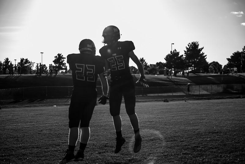 Holy Family Varsity Football vs. Mound Westonka, 8/29/19: Will Zay '21 (23) & Tien Foudray '21 (25)