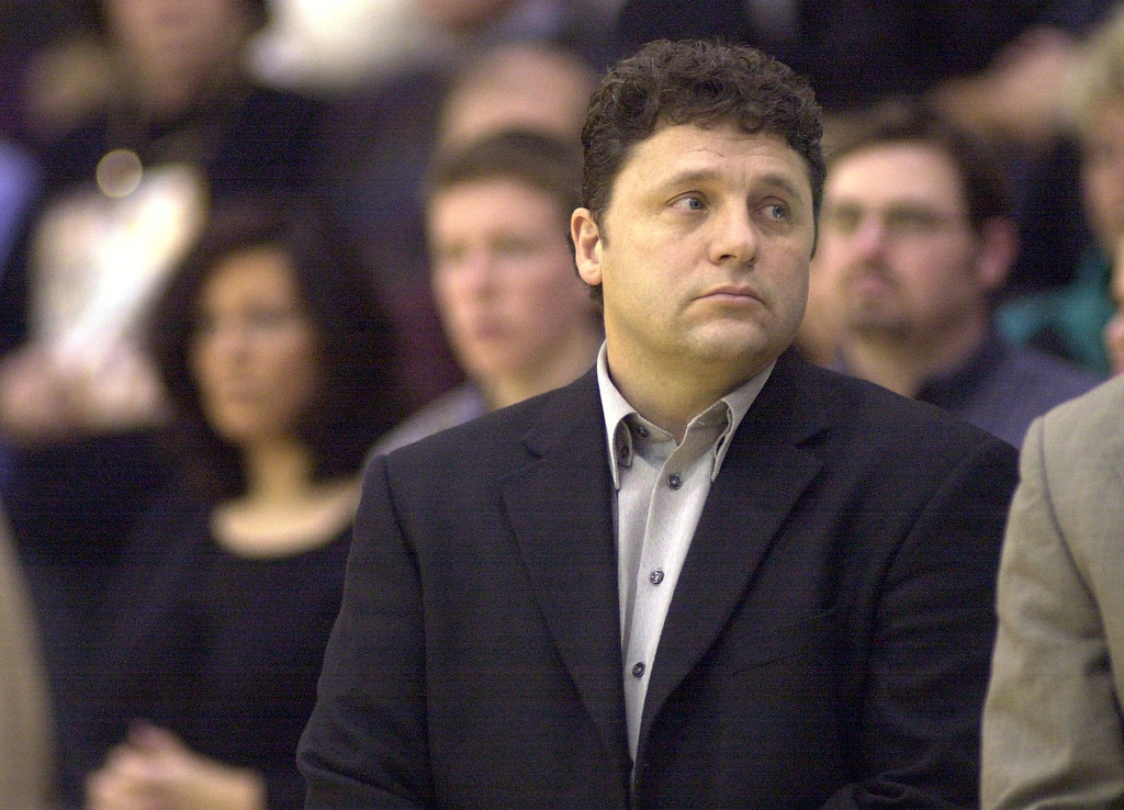 . Oakland University mens basketball head coach Greg Kampe reflects as the national anthem is played prior to the start of his team\'s game against Western Michigan University, at the O\'rena in Rochester, Mich., Saturday, December 29, 2001.