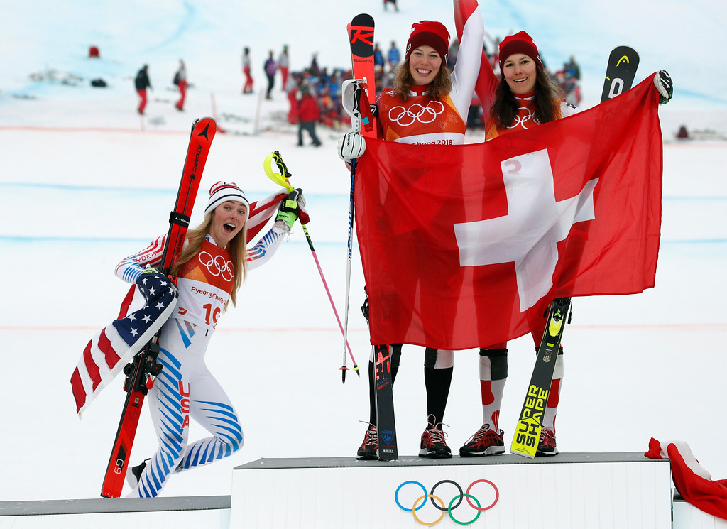 . Silver medal winner Mikaela Shiffrin, left, of the United States, poses with gold medal winner Michelle Gisin, center, of Switzerland, and bronze medalist Wendy Holdener, also of Switzerland, during the flower ceremony for the women\'s combined slalom at the 2018 Winter Olympics in Jeongseon, South Korea, Thursday, Feb. 22, 2018. (AP Photo/Christophe Ena)