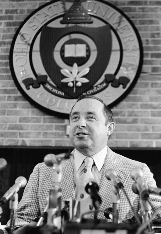 . Newly named Ohio State University head football coach Earle Bruce sits under the school\'s seal as he answers questions during a press conference at the school in Columbus, Ohio, Jan. 12, 1979. Bruce was named to replace Woody Hayes who was fired after 28 years as OSU\'s mentor. (AP Photo/Doug Martin)