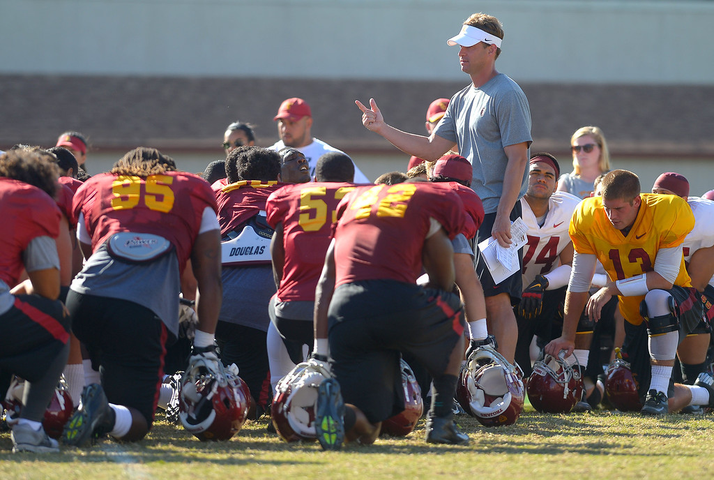 . USC football head coach Lane Kiffin talks to his team following practice August 20, 2013.(Andy Holzman/Los Angeles Daily News)