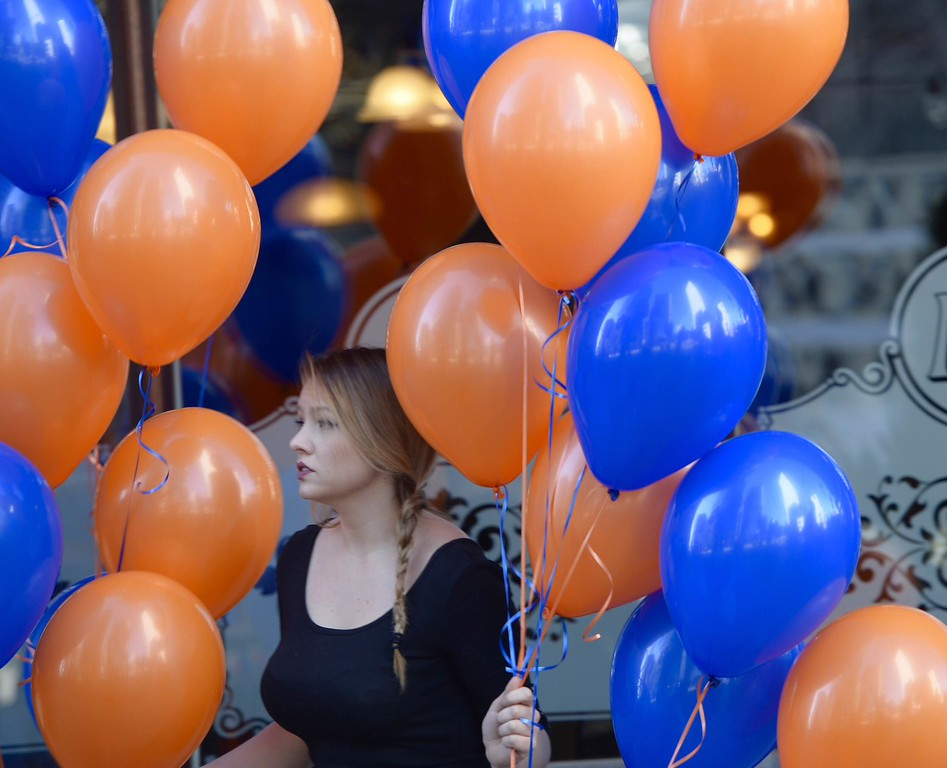 . DENVER, CO - FEBRUARY 9: Kristina Gardner with balloons at Katie Mullen\'s Tuesday morning February 9, 2016 before the Broncos Super Bowl 50 victory parade. (Cyrus McCrimmon/The Denver Post)