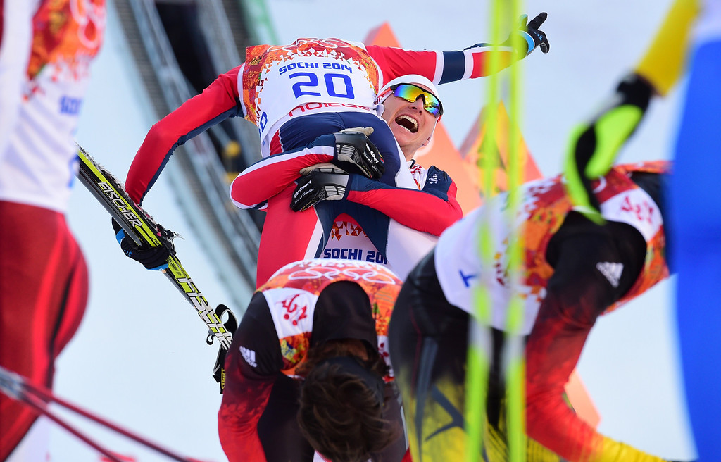 . Bronze winner Norway\'s Magnus Krog celebrates at the finish line with team mates in the Nordic Combined Individual NH / 10 km Cross-Country at the RusSki Gorki Jumping Center during the Sochi Winter Olympics on February 12, 2014, in Rosa Khutor near Sochi.  AFP PHOTO / JOHN MACDOUGALL/AFP/Getty Images