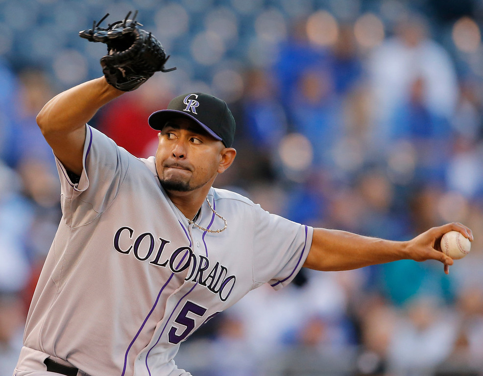 . Colorado Rockies starting pitcher Franklin Morales delivers to a Kansas City Royals batter during the second inning of a baseball game at Kauffman Stadium in Kansas City, Mo., Tuesday, May 13, 2014. (AP Photo/Orlin Wagner)