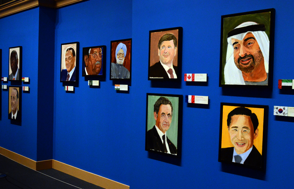""". Portraits of world leaders, which are part of the exhibit \""""The Art of Leadership: A President\'s  Diplomacy,\"""" are on display at the George W. Bush Presidential Library and Museum in Dallas, Friday, April 4, 2014. (AP Photo/Benny Snyder)"""