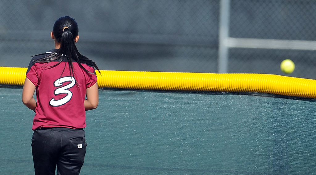 . Barstow center fielder Marissa Dado (C) watches as Northview\'s Jocelyn Marquez (not pictured) solo home run goes over the centerfield fence in the sixth inning of a CIF-SS quarterfinal playoff softball game at Northview High School on Thursday, May 23, 2013 in Covina, Calif. Northview won 5-4.  (Keith Birmingham Pasadena Star-News)