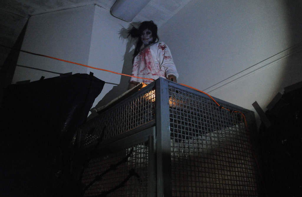 . A zombie waits for a guest to walk by during the annual Open House and Haunted Jail at Norwalk Sheriff Station in Norwalk, Calif., on Saturday, Oct. 19, 2013. Sheriff department\'s Aero Bureau, SWAT, Arson Explosives Detail, Recruitment unit, along with the L.A. County Fire Department, U.S. Army with a military vehicle, CHP, and the Sheriff\'s Department dragster were on display.  (Keith Birmingham Pasadena Star-News)