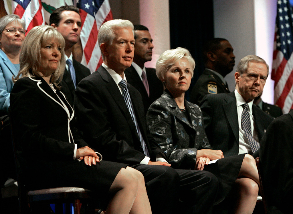 . Former Gov. Gray Davis, second from left, and his wife, Sharon, left, along with former Gov. Pete Wilson, far right, and his wife, Gayle Wilson, second from right, watch as Gov. Arnold Schwarzenegger is sworn in for a second term in Sacramento, Calif., Friday, Jan. 5, 2007. (AP Photo/Rich Pedroncelli, Pool)