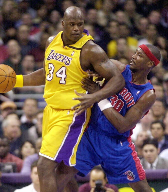 . Los Angeles Lakers\' Shaquille O\'Neal (34) looks to maneuver against Detroit Pistons\' Cliff Robinson during the second quarter Thursday, Feb. 27, 2003, in Los Angeles. (AP Photo/Ric Francis)