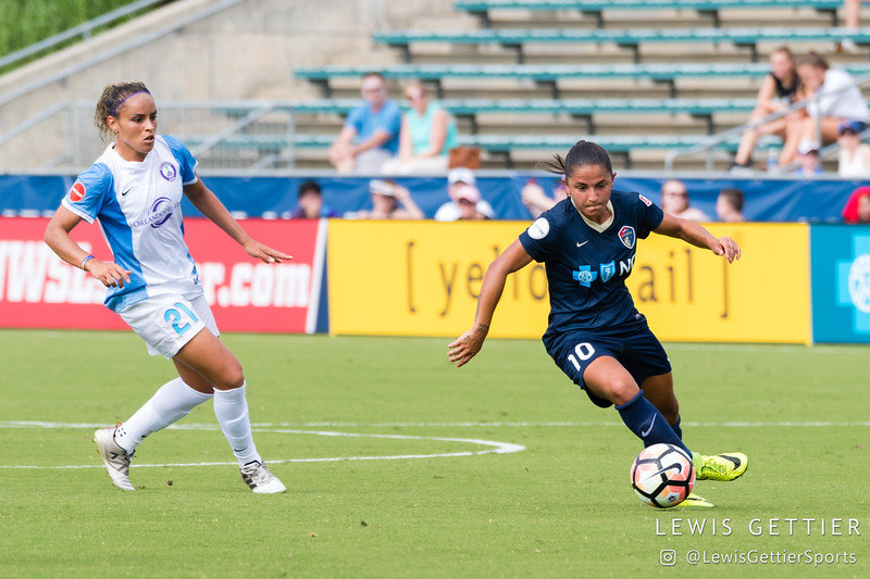 Debinha (10) and Monica Hickmann Alves (21) during a match between the NC Courage and the Orlando Pride in Cary, NC in Week 3 of the 2017 NWSL season. Photo by Lewis Gettier.