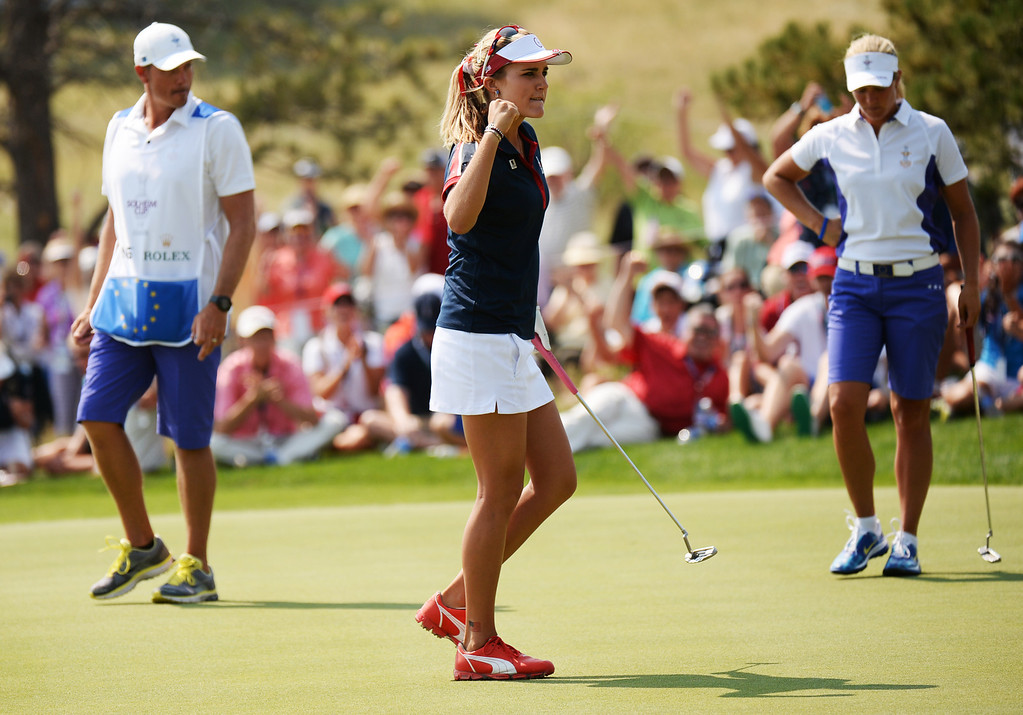 . PARKER, CO. - August 16: Lexi Thompson of team USA, front, celebrate her birdie putt on 9th green during 2013 Solheim Cup at Colorado Golf Club. Parker, Colorado. August 16, 2013. (Photo By Hyoung Chang/The Denver Post)