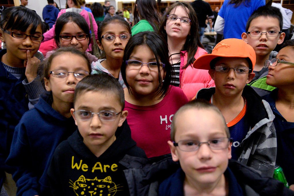 . Students from Force Elementary School pose with their new prescription glasses  Monday, April 14, 2014, in Denver after Denver Broncos linebacker Von Miller\'s Foundation, Von\'sVision, distributed prescription glasses to more than 100 underprivileged Children at Sports Authority Field. (Photo by John Leyba/The Denver Post)
