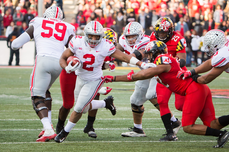Ohio State RB #2 J.K. Dobbins breaks a tackle by Maryland LB #22 Isiah Davis