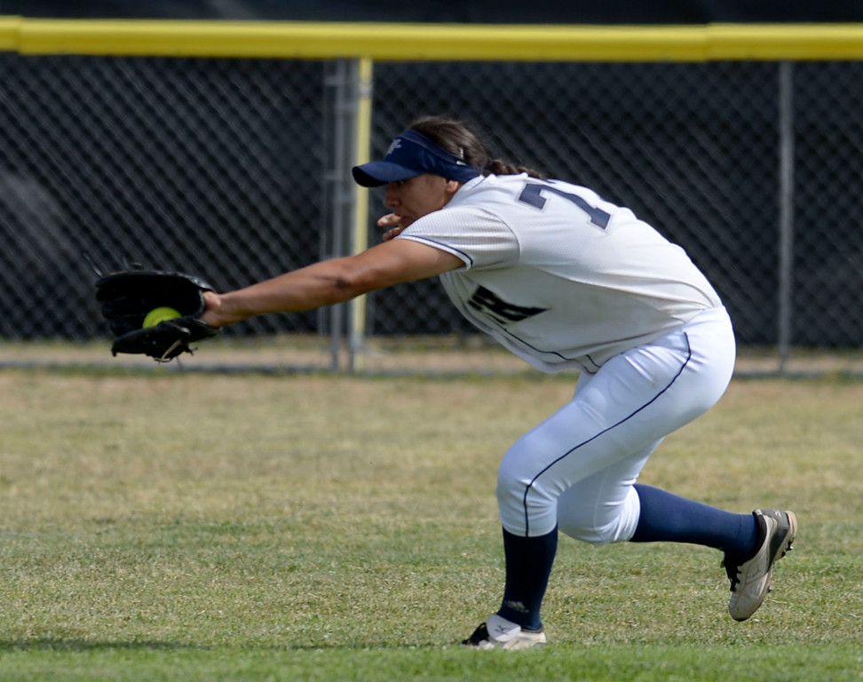 . North\'s Vanessa Gonzalez (77) makes a catch on a sinking Peninsula hit to center in a first round CIF SS Division III softball game Thursday in Torrance. Peninsula won 4-1. 20130516 Photo by Steve McCrank / Staff Photographer