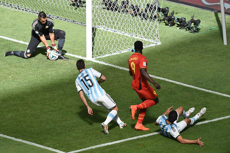 . Argentina\'s goalkeeper Sergio Romero (L) makes a save during a quarter-final football match between Argentina and Belgium at the Mane Garrincha National Stadium in Brasilia during the 2014 FIFA World Cup on July 5, 2014.   (EVARISTO SA/AFP/Getty Images)