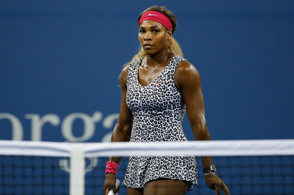 . Serena Williams, of the United States, reacts after losing a game to Taylor Townsend, of the United States, during the opening round of the U.S. Open tennis tournament Tuesday, Aug. 26, 2014, in New York. (AP Photo/Jason DeCrow)