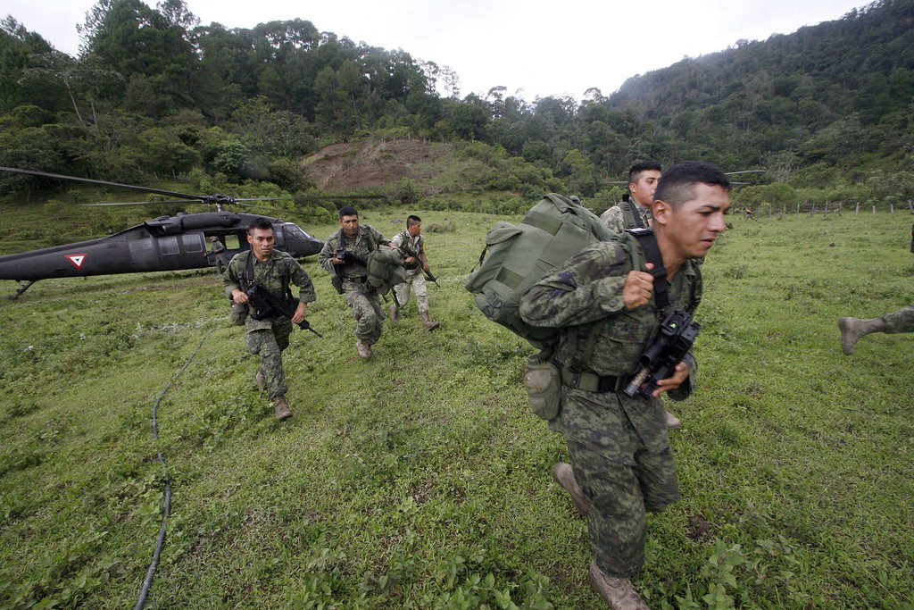 . Soldiers disembark from a helicopter at La Pintada, state of Guerrero, Mexico, on September 19, 2013 as heavy rains hit the country.  AFP PHOTO/Pedro PARDO/AFP/Getty Images