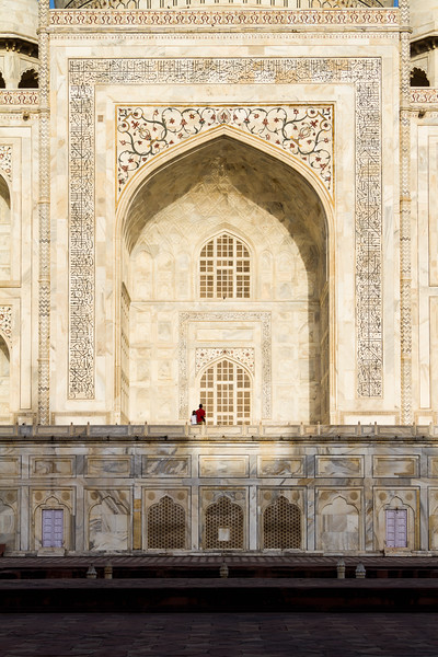 Two Tourists Gaze In Wonder At The Architecture Of The Taj Mahal, Agra, India, Asia