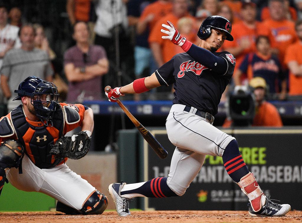 . Cleveland Indians\' Francisco Lindor strikes out to end the team\'s baseball game against the Houston Astros, Friday, May 18, 2018, in Houston. Houston won 4-1. (AP Photo/Eric Christian Smith)