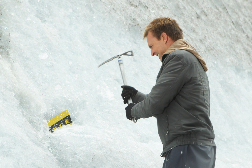 . Emmy award winning host Phil Keoghan demonstrates the Active Route Marker in Juneau, Alaska.  Teams must  take a helicopter to Norris Glacier where they chip away at the ice to reveal the next clue on THE AMAZING RACE Sunday, Dec. 8 (8:00-10:00 PM, ET/PT) on the CBS Television Network. Photo: Monty Brinton/CBS©2013 CBS Broadcasting, Inc. All Rights Reserved