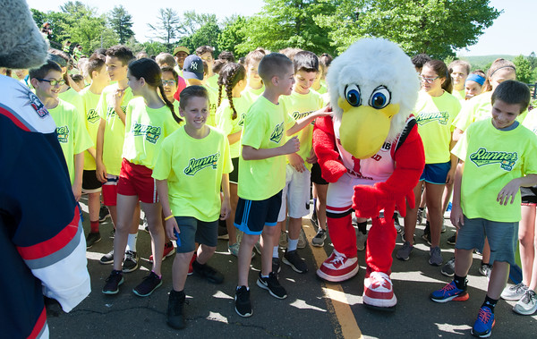 05/24/18 Wesley Bunnell | Staff Sonar from the Hartford Wolfpack and Howie the Hawk from the University of Hartford warm up with school children before the start of a 1 mile run around Walnut Hill Park on Thursday morning. The Hartford Marathon Foundation hosted 12 area schools on Medal Day as the culmination of their HMF Fit Kids program. The program is a 6 week goal oriented running program for elementary and middle school students to help develop a healthy and active lifestyle.