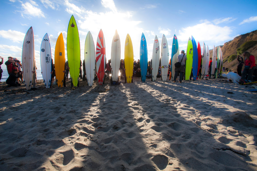 Description of . Surfers line up for the opening ceremony for the Mavericks big-wave surfing contest in Half Moon Bay,  Calif. on Friday, Nov. 9, 2012. The contest will run sometime between Nov. 9 and March 31, provided the right surfing conditions arise. (John Green/Staff)