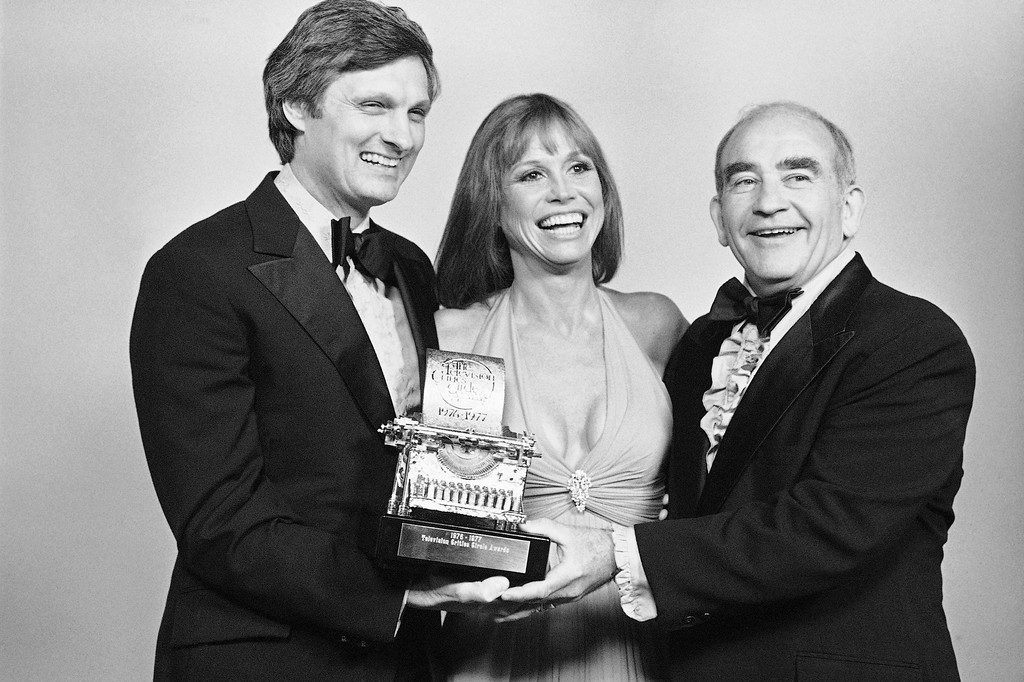 . Actor Alan Alda, actress Mary Tyler Moore and actor Ed Asner hold one of the Television Critics Circle Awards presented them on Monday, April 11, 1977 at ceremonies in Los Angeles. Alda tied with Asner for achievement in comedy-male, while Mary Tyler Moore won for achievement in comedy-female. Ed Asner also won the supporting male acting award for his acting in ?Roots.? (AP Photo)