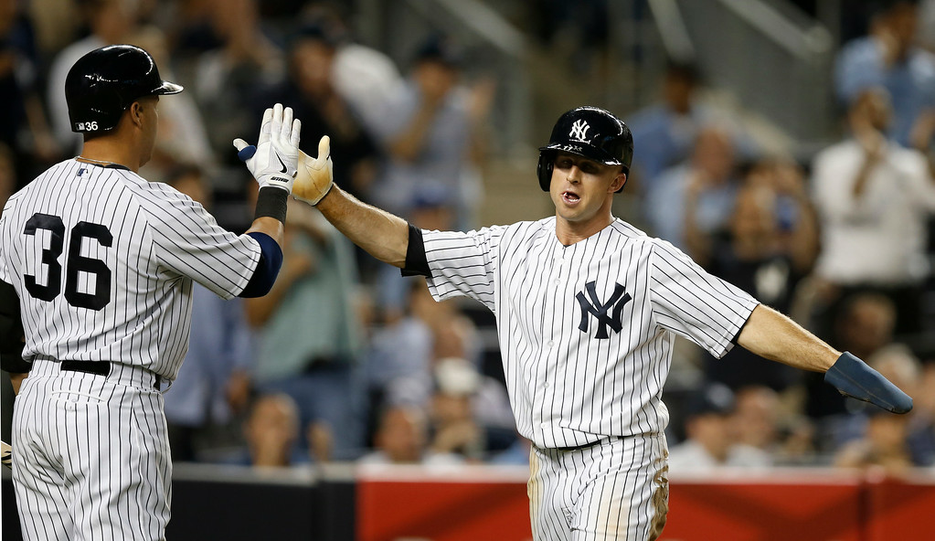 . New York Yankees designated hitter and on-deck batter Carlos Beltran (36) greets the Yankees Brett Gardner (11) after Gardner scored on Mark Teixiera\'s eighth-inning, RBI single in a baseball game against the Detroit Tigers at Yankee Stadium in New York, Wednesday, Aug. 6, 2014.  (AP Photo/Kathy Willens)