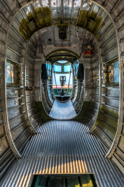 Looking back to the the tail gunner, from the side gunner position, just behind the bomb bay.