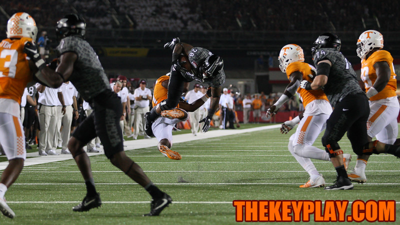 RB Shai McKenzie gets flipped on a tackle by Tennessee's Jalen Reeves-Maybin. (Mark Umansky/TheKeyPlay.com)