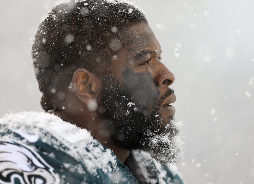 . Defensive end Clifton Geathers #90 of the Philadelphia Eagles looks on from the sidelines in the first half during a game against the Detroit Lions  at Lincoln Financial Field on December 8, 2013 in Philadelphia, Pennsylvania. (Photo by Rich Schultz /Getty Images)