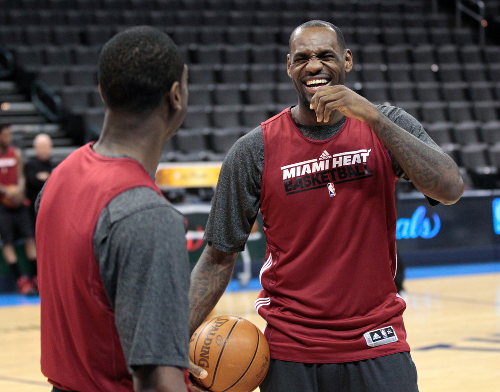. Miami Heat\'s LeBron James, right, laughs with teammate Dwyane Wade during basketball practice Wednesday, June 13, 2012, in Oklahoma City. Game 2 of the NBA finals between the Heat and the Oklahoma City Thunder is Thursday. (AP Photo/Sue Ogrocki)