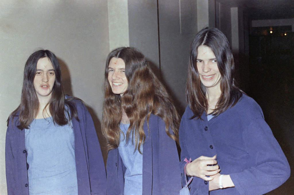 . Charles Manson followers, from left: Susan Atkins, Patricia Krenwinkel and Leslie Van Houten, shown walking to court to appear for their roles in the 1969 cult killings of seven people, including pregnant actress Sharon Tate, in Los Angeles, Calif., Aug. 20, 1970.  (AP Photo/George Brich)