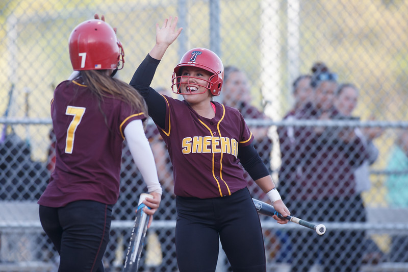 Sheehan's Mikaeyla Daddio (7) gets a high five from Becca Souza after hitting a home run Wednesday at Pragemann Park in Wallingford  May. 13, 2015 | Justin Weekes / For the Record-Journal